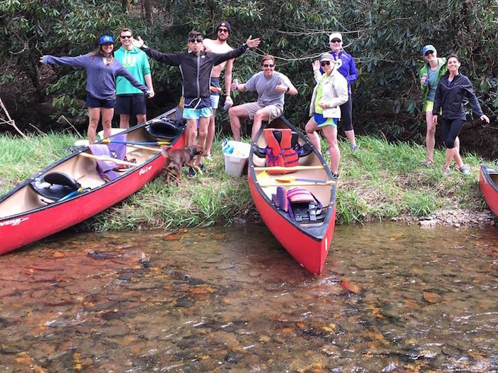 Trail Roots runners have fun canoeing on the New River in North Carolina.