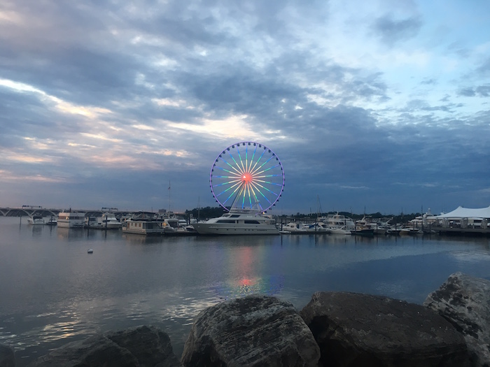 The Ferris Wheel in National Harbor is lit in rainbow colors at sunset to remember Orlando shooting victims.