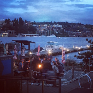 Fire pit at Westward in Seattle at sunset.