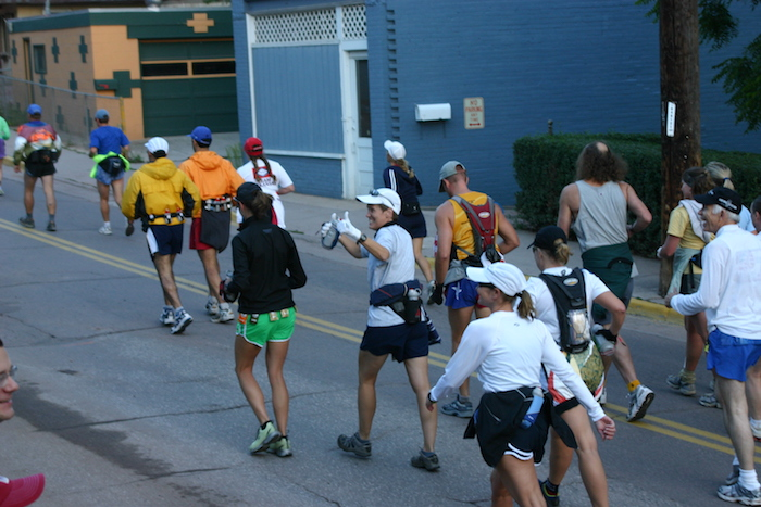 Runners heading uphill through town at beginning of 2005 Pikes Peak Marathon