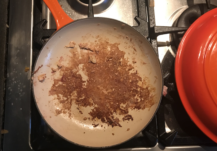 cooking pan with burned bits on bottom