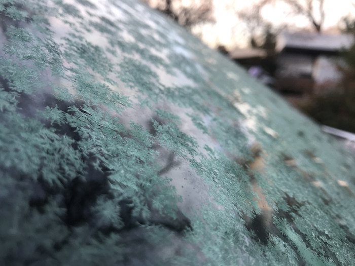 close-up of ice crystals on car windshield by Leah Fisher Nyfeler