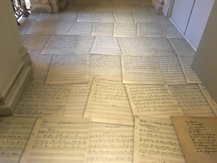 Sheet music paves the exhibit entrance at the Palau Robert in Barcelona
