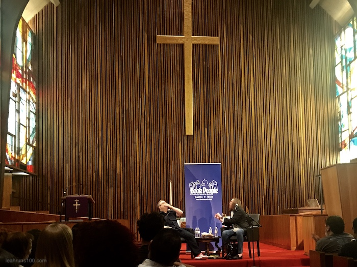 Patton Oswalt laughing with interviewer Suzy Spencer at Austin's Central Presbyterian Church