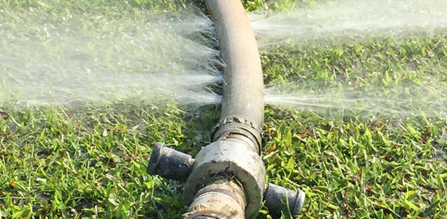 water-pipe-leaking-on-grass