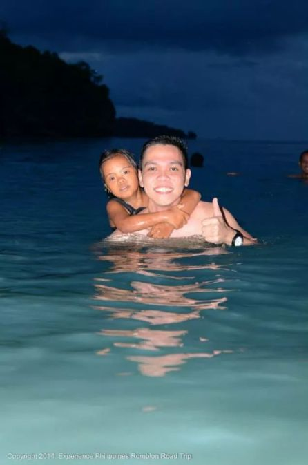 Swimming with the local kids in Cobrador Island, Romblon.