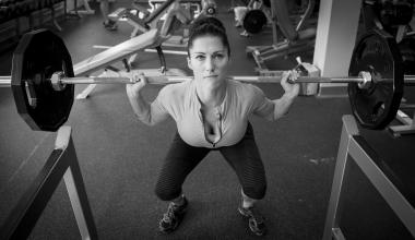 1st Lt. Bobbie-Jean Johnson, 919th Special Operations Wing, squats with two 45-pound weights at the fitness center on Duke Field, Fla. In November, the Airman won all the divisions she entered at the Northwest Florida Flex Fest in Pensacola. (U.S. Air Forc