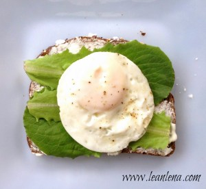 Whole wheat bread, 1/3 less fat Philadelphia cheese, baby lettuce and an egg fried on coconut oil
