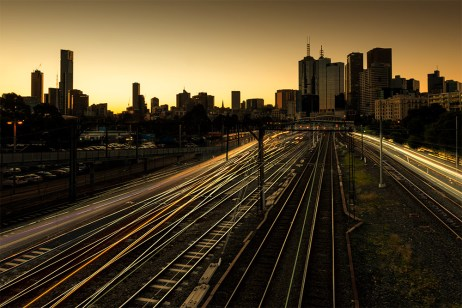 trains-melbourne-city-sunset-buildings