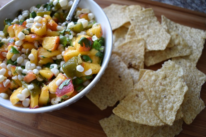 bowl of peach salsa with tortilla chips