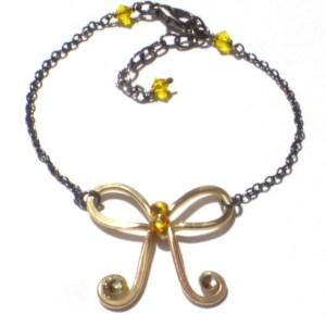 Bow Anklet Gold Iron Gilded Sunbeams