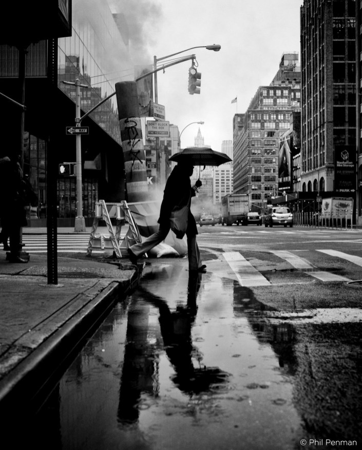 January 17th 2012: People seen walking on a rainy day through the steam clouds in New York City, USA. Photography by Phil Penman www.philpenman.com Cellphone: 917 496 1644 Email: ppenman@me.com i