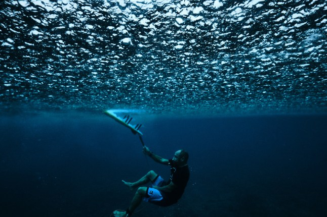 capture one raw image editor blogpost russell ord surfer under water holding rope attached to surfboard