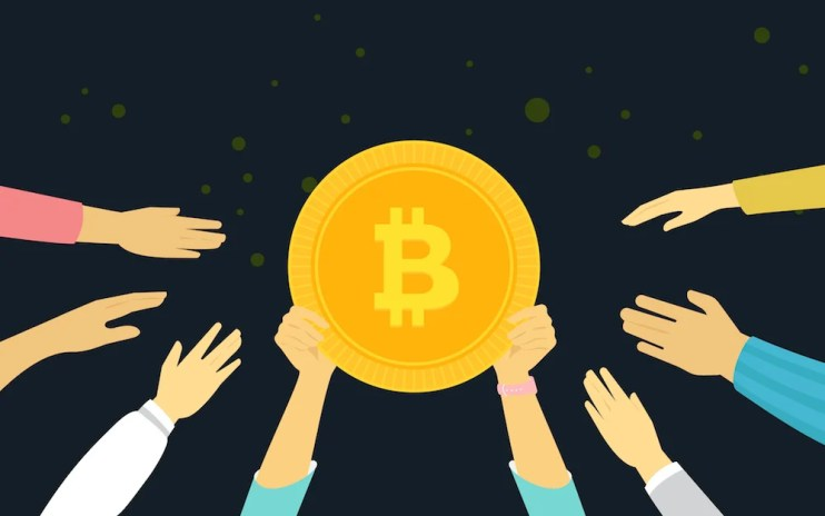 Black Background with a bunch of people holding up a golden bitcoin