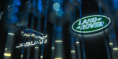 Jaguar and Land rover logos on glass pane