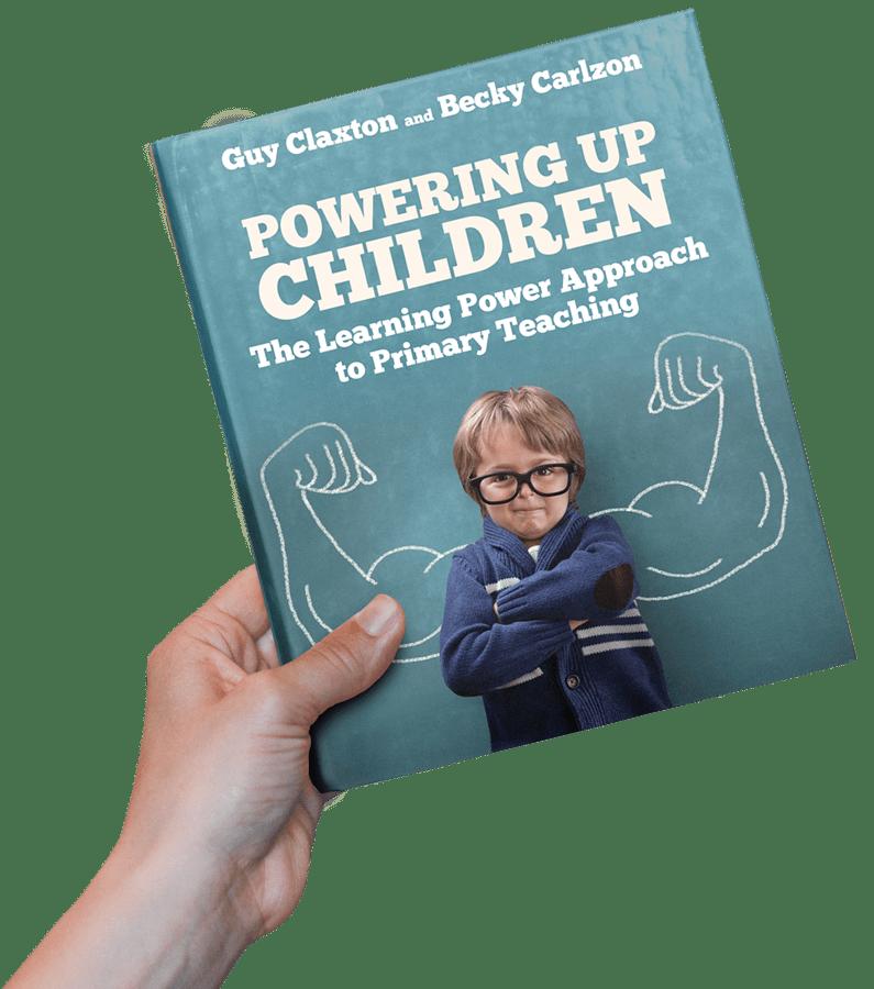 Hand holding book - Powering Up Children