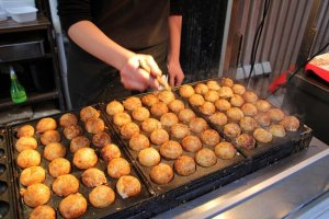 A street vendor making takoyaki