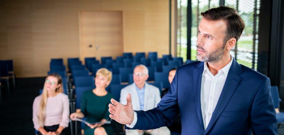 Businessman coach in the auditorium