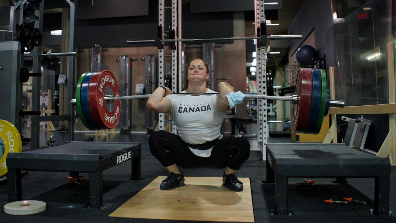 Female Olympic Weightlifter Clean
