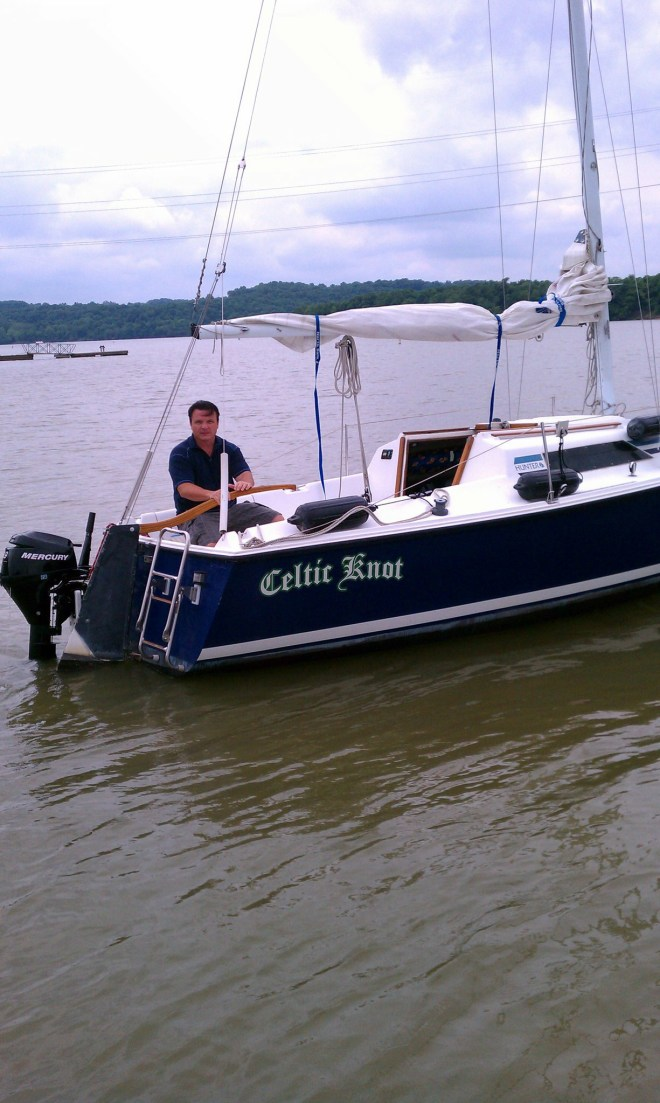 """Our first sailboat....a Hunter 23...I'm not sure why I look so angry in this picture...maybe it was my """"pirate face"""""""