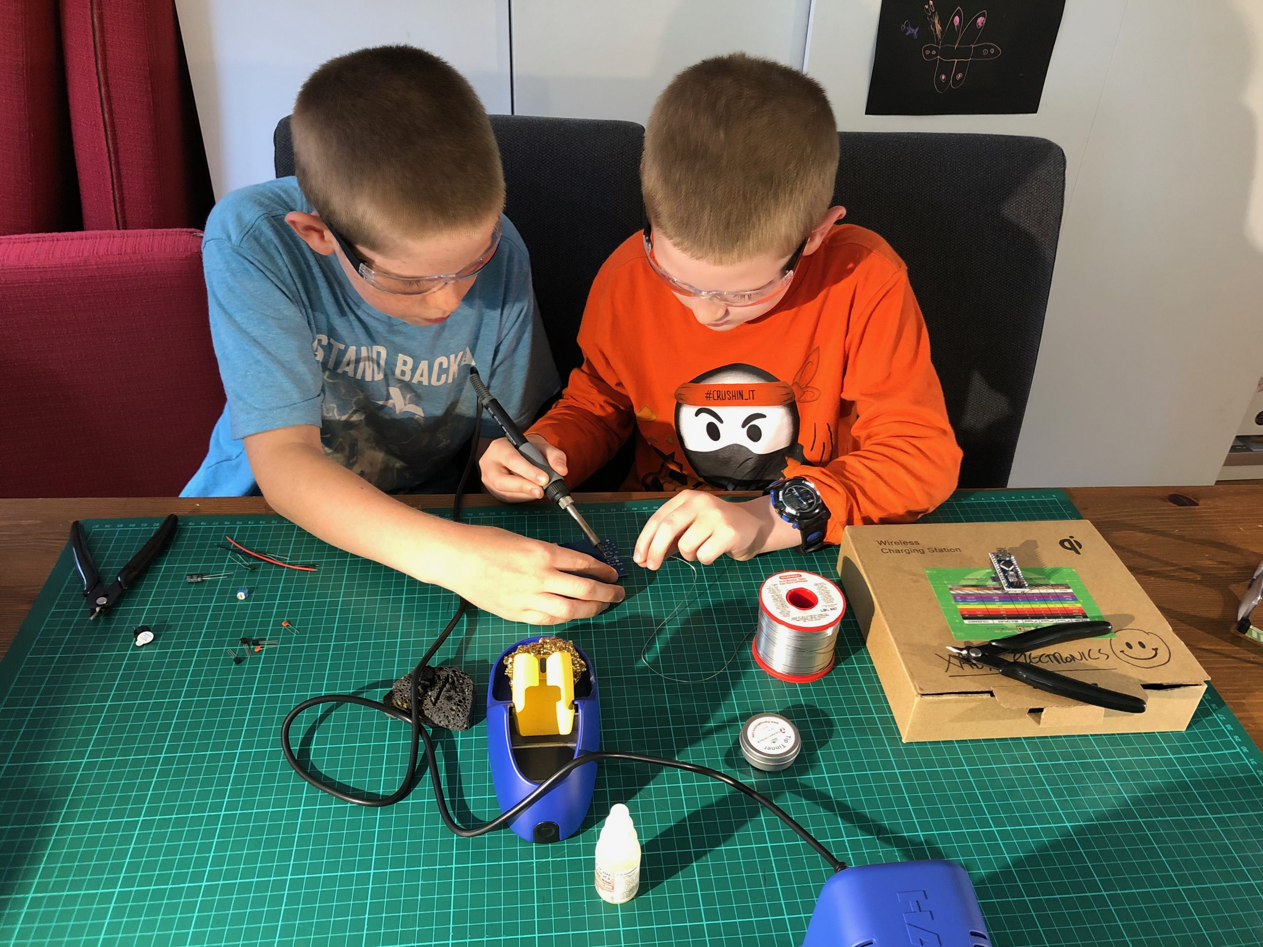brothers soldering together