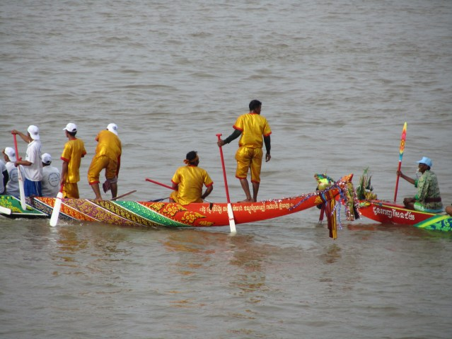 You can see the front and back of the boats here.  The decoration is much simpler than the dragon boats.