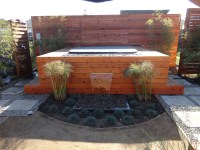 Custom outdoor water feature, & fire pit reset into spa ...