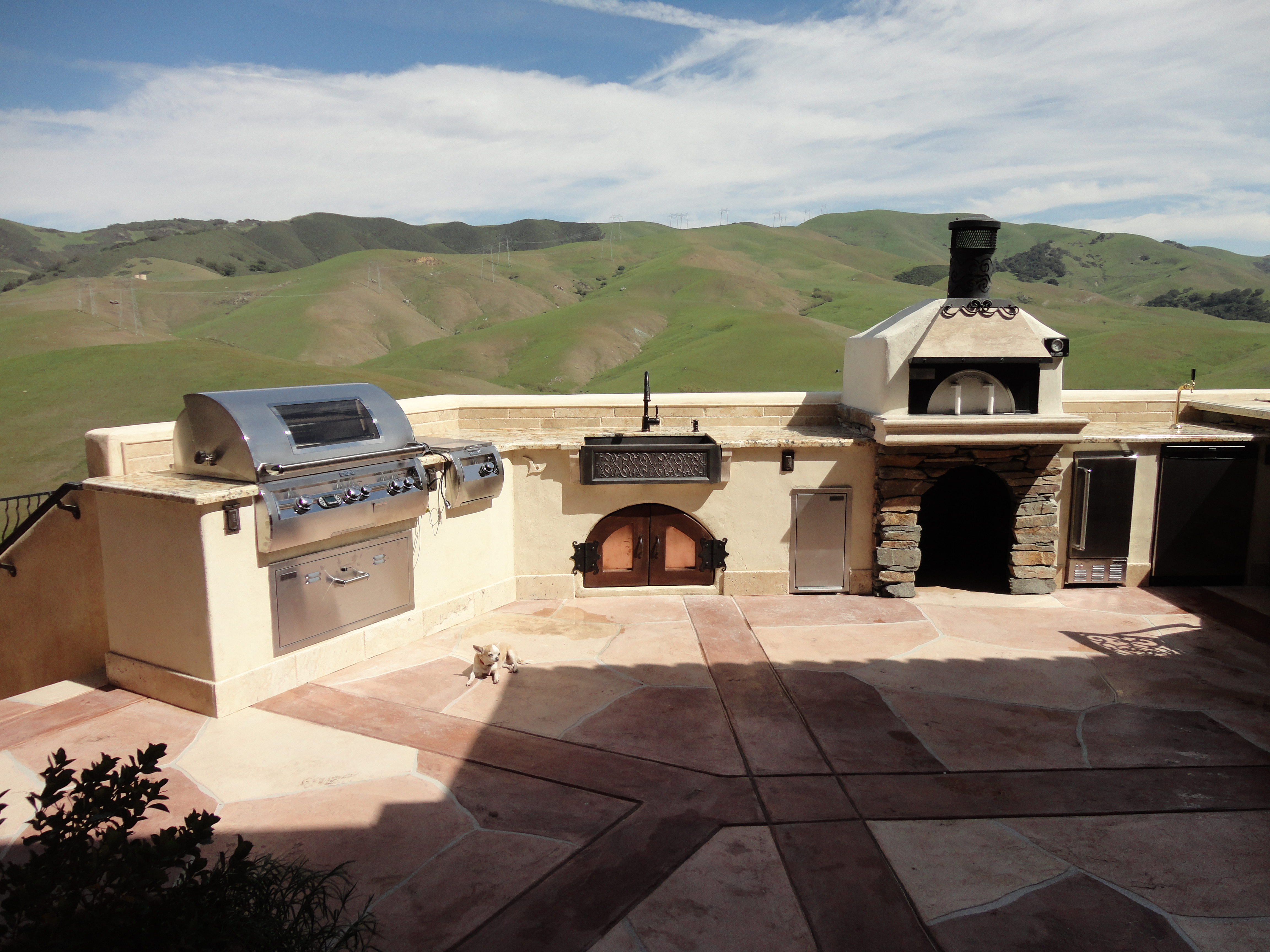 outdoor kitchen oven premade island tuscan themed with water featrure fire pit