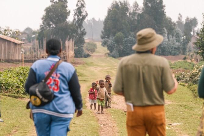 Walking through communities while gorilla trekking