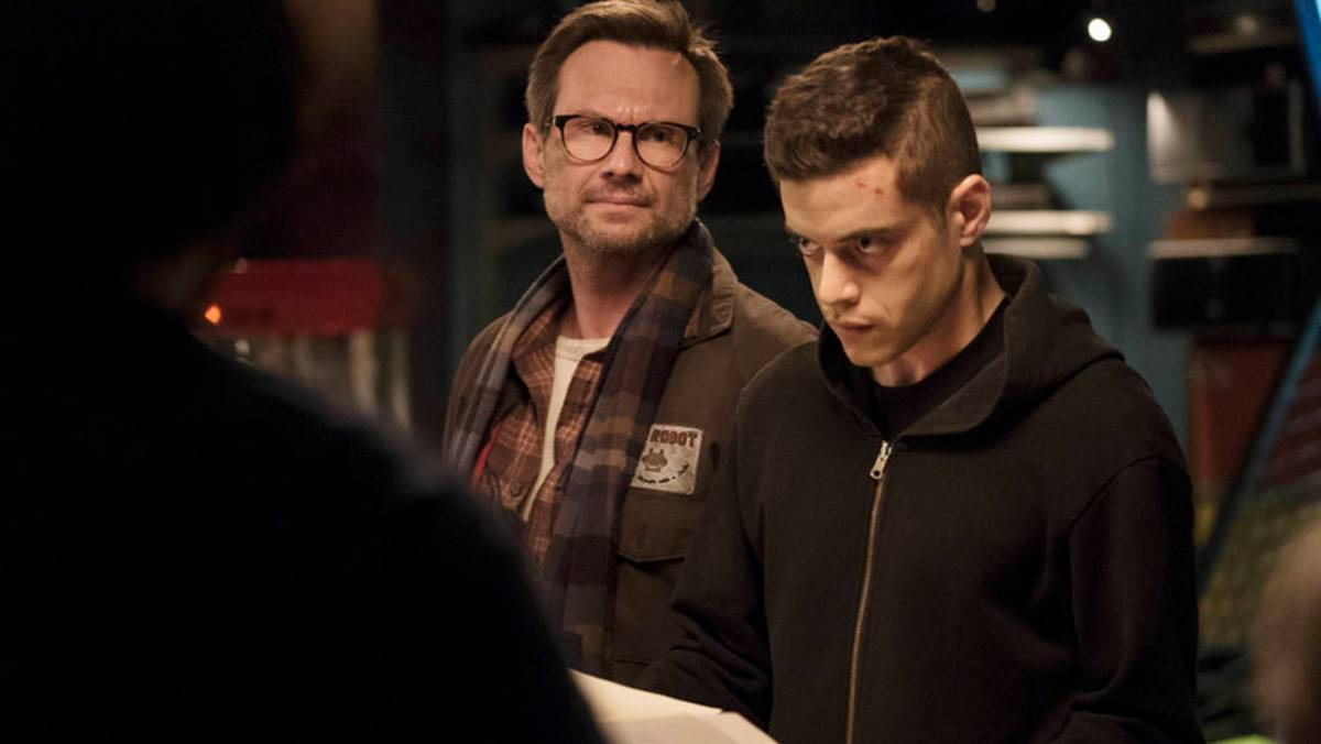 "MR. ROBOT -- ""da3m0ns.mp4"" Episode 104 -- Pictured: (l-r) Christian Slater as Mr. Robot, Rami Malek as Elliot -- (Photo by: Virginia Sherwood/USA Network)"