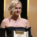 German actress Diane Kruger poses on stage after she was awarded with the Best Actress Prize for her part in 'Aus dem Nichts' (In the Fade) on May 28, 2017 during the closing ceremony of the 70th edition of the Cannes Film Festival in Cannes, southern France. / AFP PHOTO / Valery HACHE