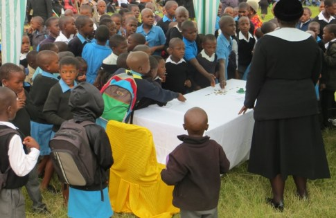 Matelile Primary School students bringing their offering