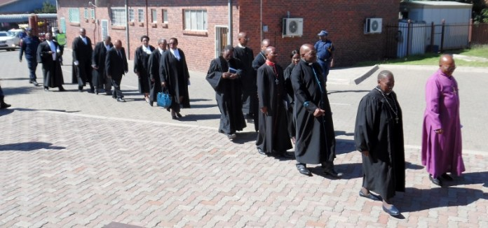 Members of the CCL and Judiciary process to the service