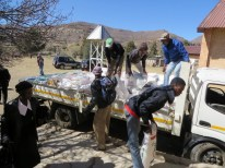 Off-loading food aid at Mohale's Hoek LECSA