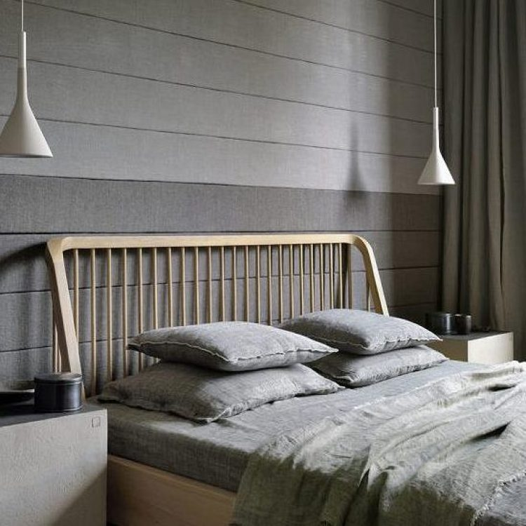 farmhouse bed with two pendant lights.