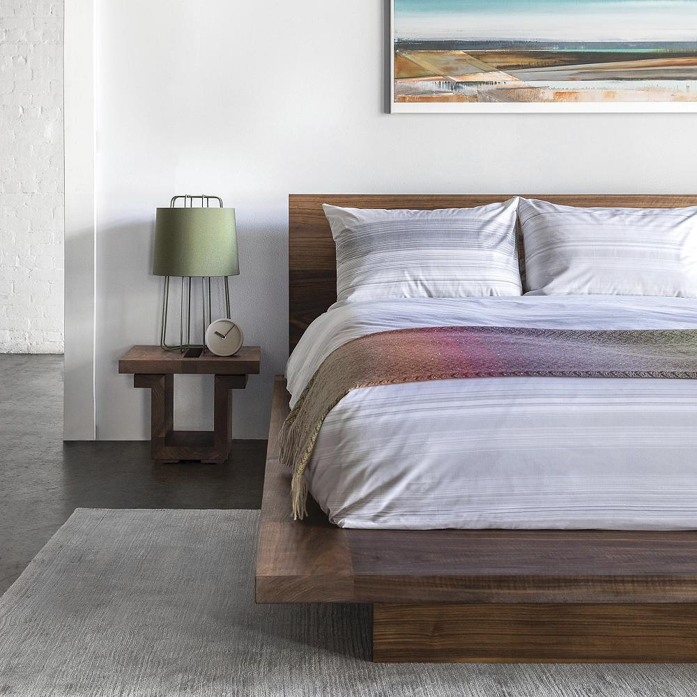modern wood platform bed and matching nightstand.