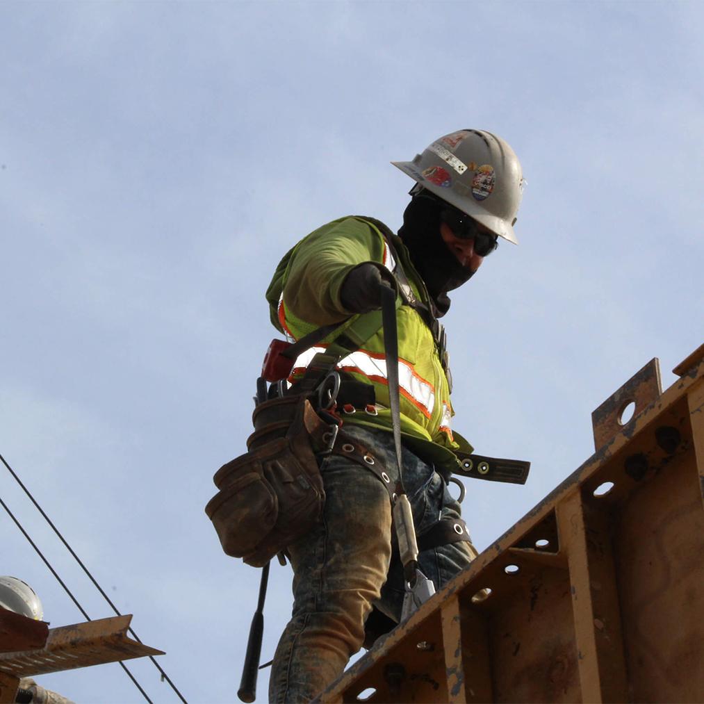 Construction Worker Climbing