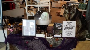 Here is our table decorated for Halloween, 2015, Chapters Peterborough. The wailing ghost is voice and motion activated. Spooky.