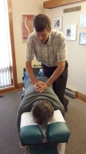 Dr. Kevin Matheson, Matheson Chiropractic Clinic, Orilla, adjusting a patient.