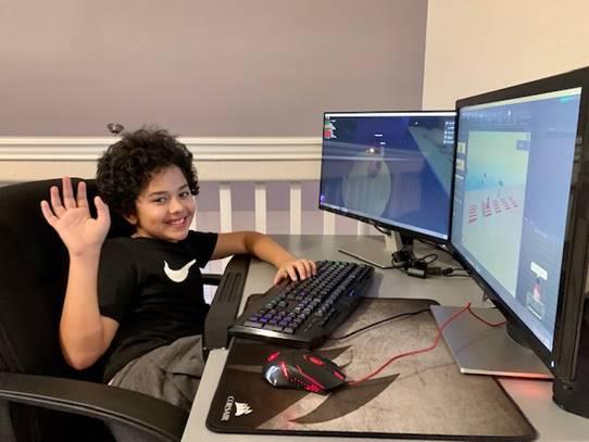 A child attends a virtual summer camp