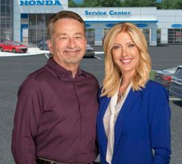 Roger and Kim Elswick pose before their business