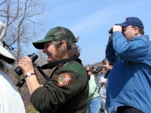 Ranger Peg Burman identifies migratory birds in the park