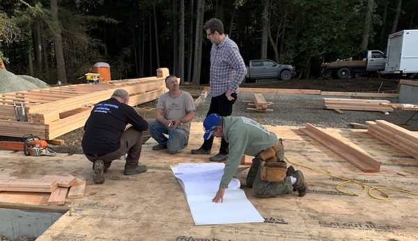 Drew the Builder (L), John the Architect (Standing), Chris and Chris, the Framers