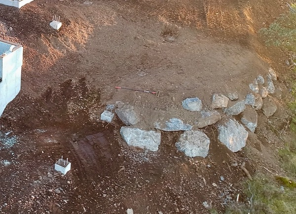 Large rocks form a retaining wall
