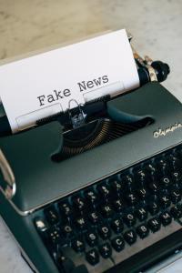 typewriter with fake news on paper