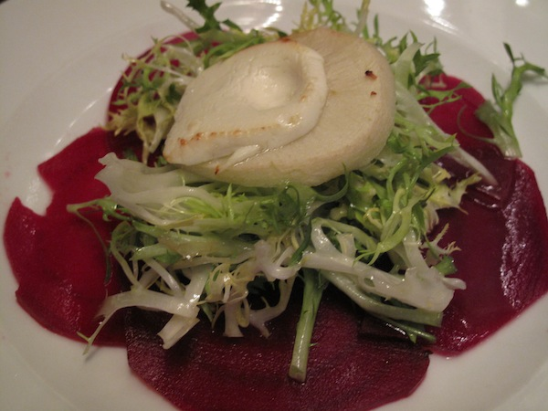 Roasted red beets and frisée salad with goat cheese over apple