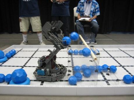 Robot dumping balls into goal