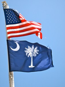 Flags flying on the ferry to Ft. Sumter - photo by Earl