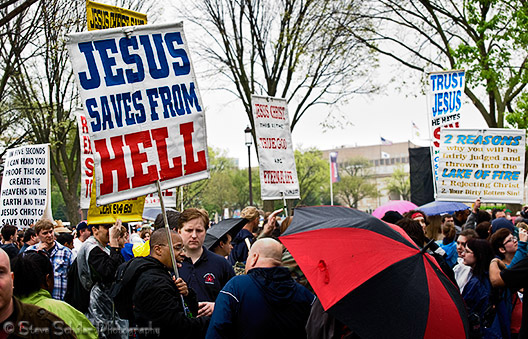All the protesters were fundamentalist Christians. Each sign was held by a person who had had no trouble finding people to talk to him.