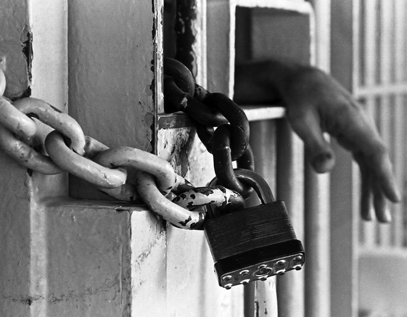 Hands bars lock prison